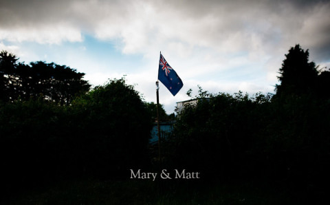 New Zealand flag flying in rural new zealand